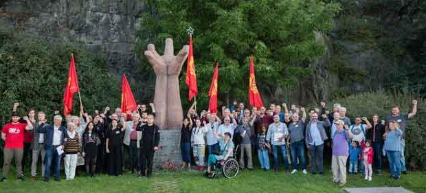 Deltagarna i SKPORG19 samlade vid La Mano, monumentet över de stupade Spanienfrivilliga.